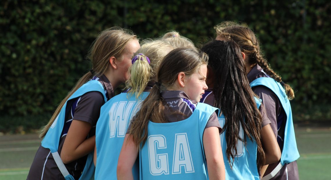group of netball girls in a huddle