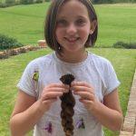 child holding a plait