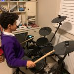 Child practising the drums