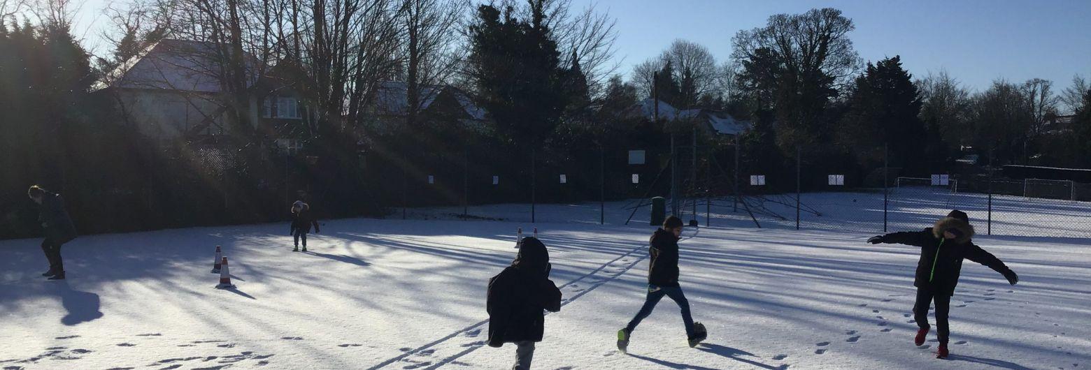 children running around in the snow