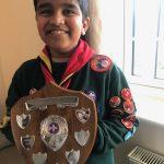 child holding award