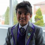 child wearing school uniform