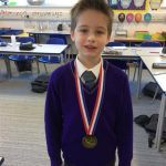 Young student with medal